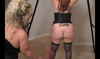Thick Dominatrix with her victim