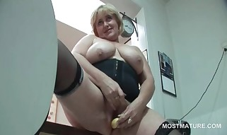 Giant Titted Mature Sweetheart Smashing Herself On The Desk