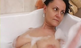 Kinky grandma in the bath